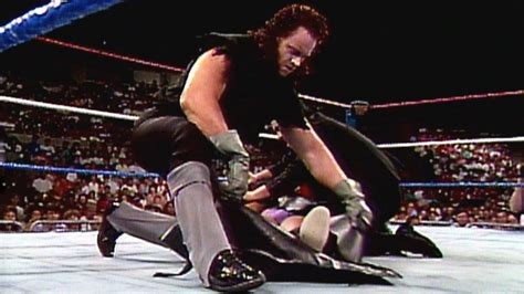 The Undertaker puts a beaten opponent in a body bag: WWE
