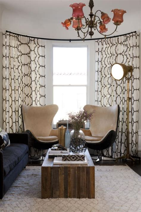Eclectic Living Room With Mid-Century Modern Egg Chairs | HGTV